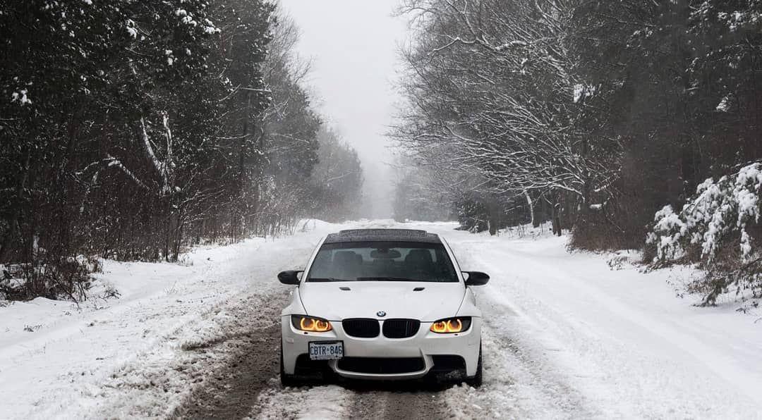 A BMW E92 on a snowy road